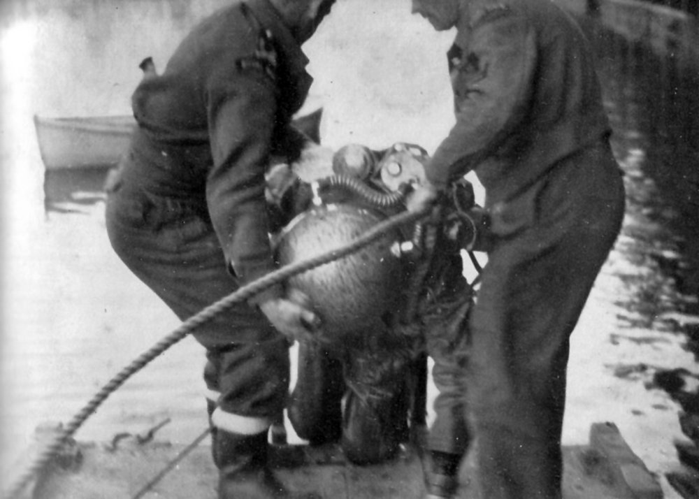 Lt George Gosse GC RANVR in Mine Recovery Suit after defuzing GD 'Oyster' pressure mine at Bremen 7 May 1945