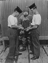 'P' Party trainee being dressed in Shallow Water Diving Suit 3 med.jpg