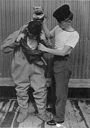 'P' Party trainee being dressed in Shallow Water Diving Suit 1 med.jpg