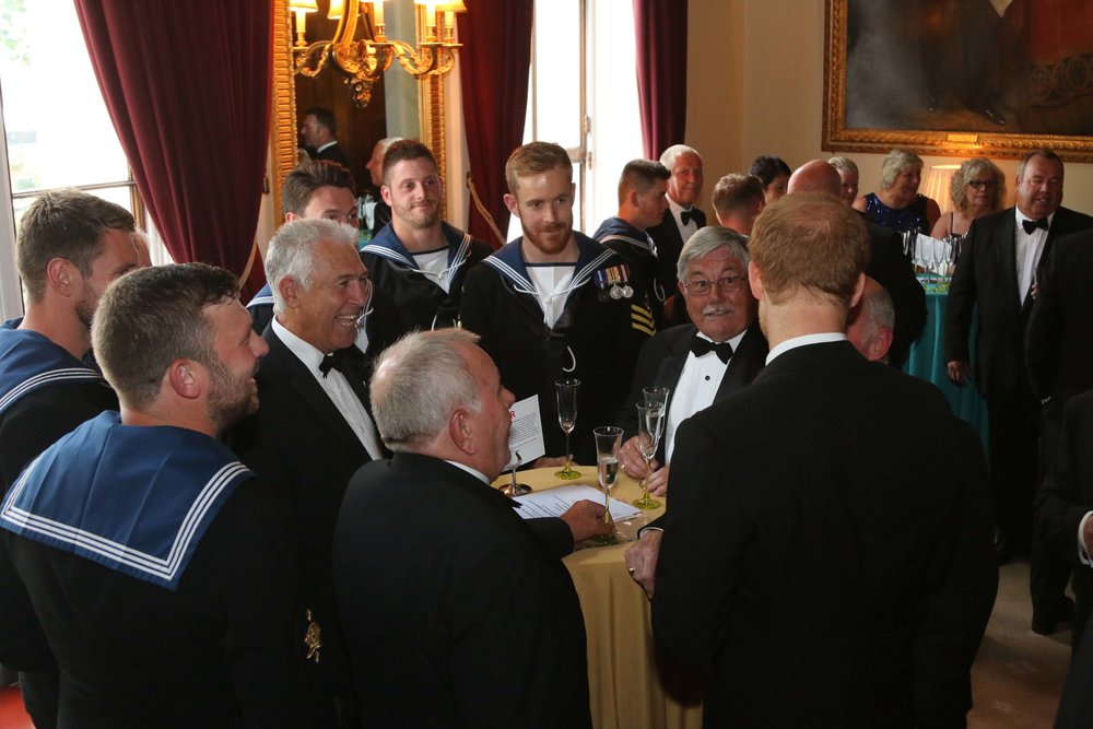 Prince Harry (Commodore-in-Chief Small Ships & Diving) with serving and retired minewarfare & diving personnel at the Project Vernon 'Falklands 35' fundraising dinner at Trinity House in July 2017.