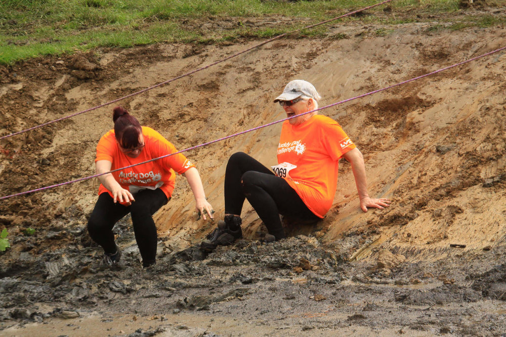 Mud slide at the Muddy Dog Challenge