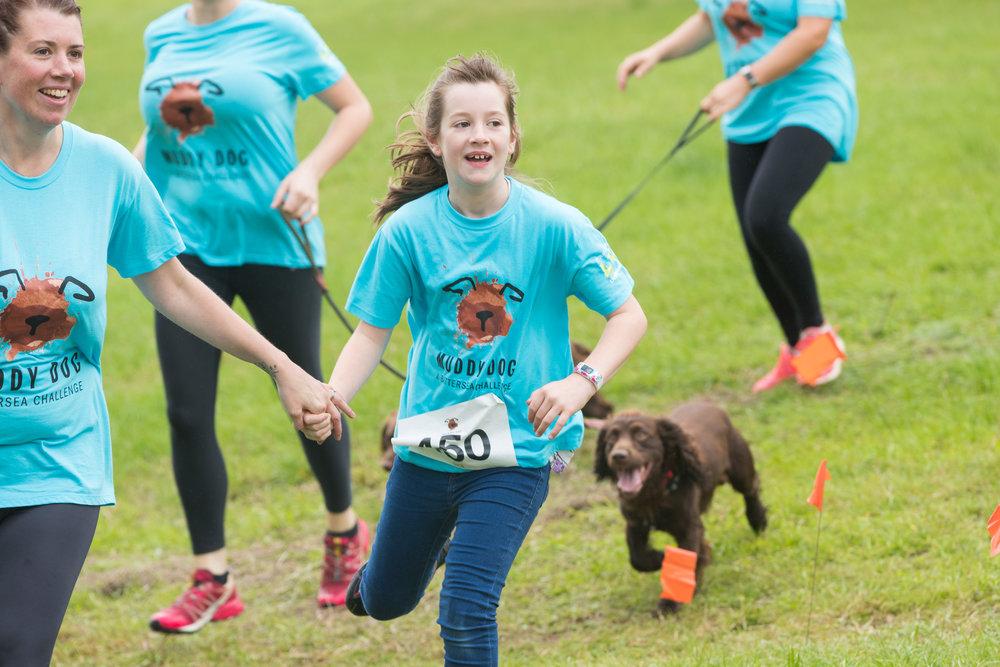 Cardiff kid running with happy dog.jpg
