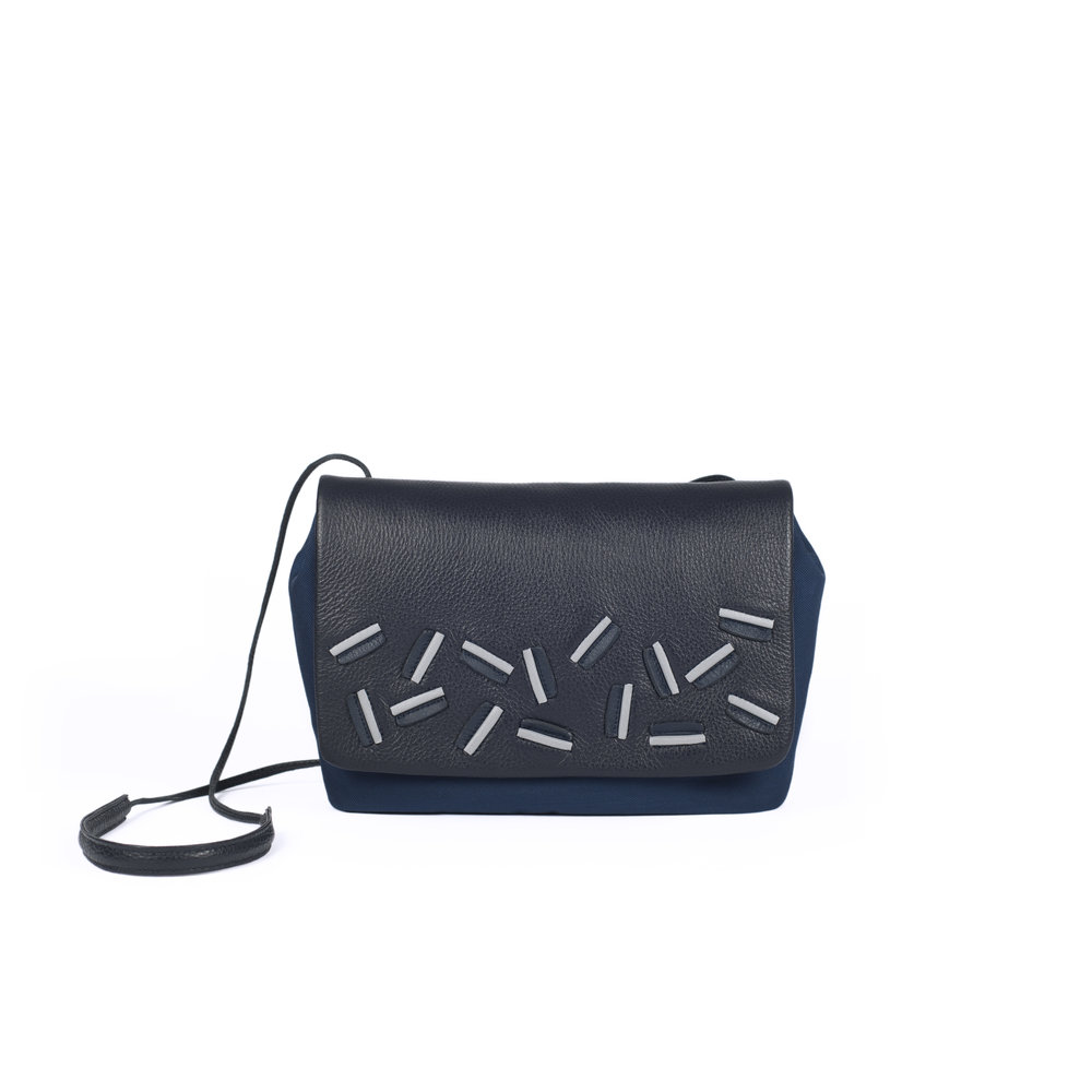 leather clutch handbag with reflective details   Noelle