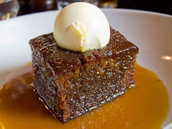 Britain - A sponge-like pudding made using dates and served with toffee sauce and cream or custard.