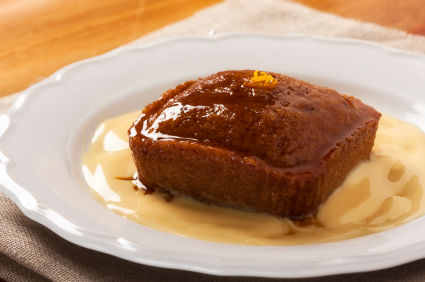 South Africa - A hot pudding with a caramel taste and spongy texture. Some like it just with custard, some prefer merely ice cream. The die-hard fans want both.