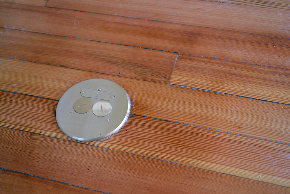 Electrical and data ports in the floor means no more tripping over computer and conference phone cables!