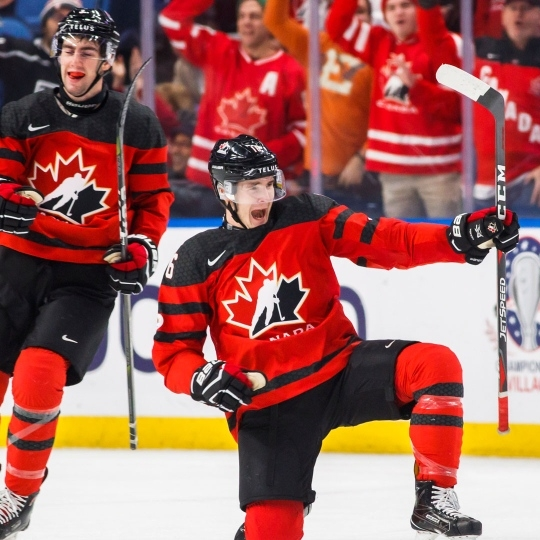 Taylor Raddysh celebrates a goal for Team Canada (Photo by The Canadian Press / Mark Blinch)
