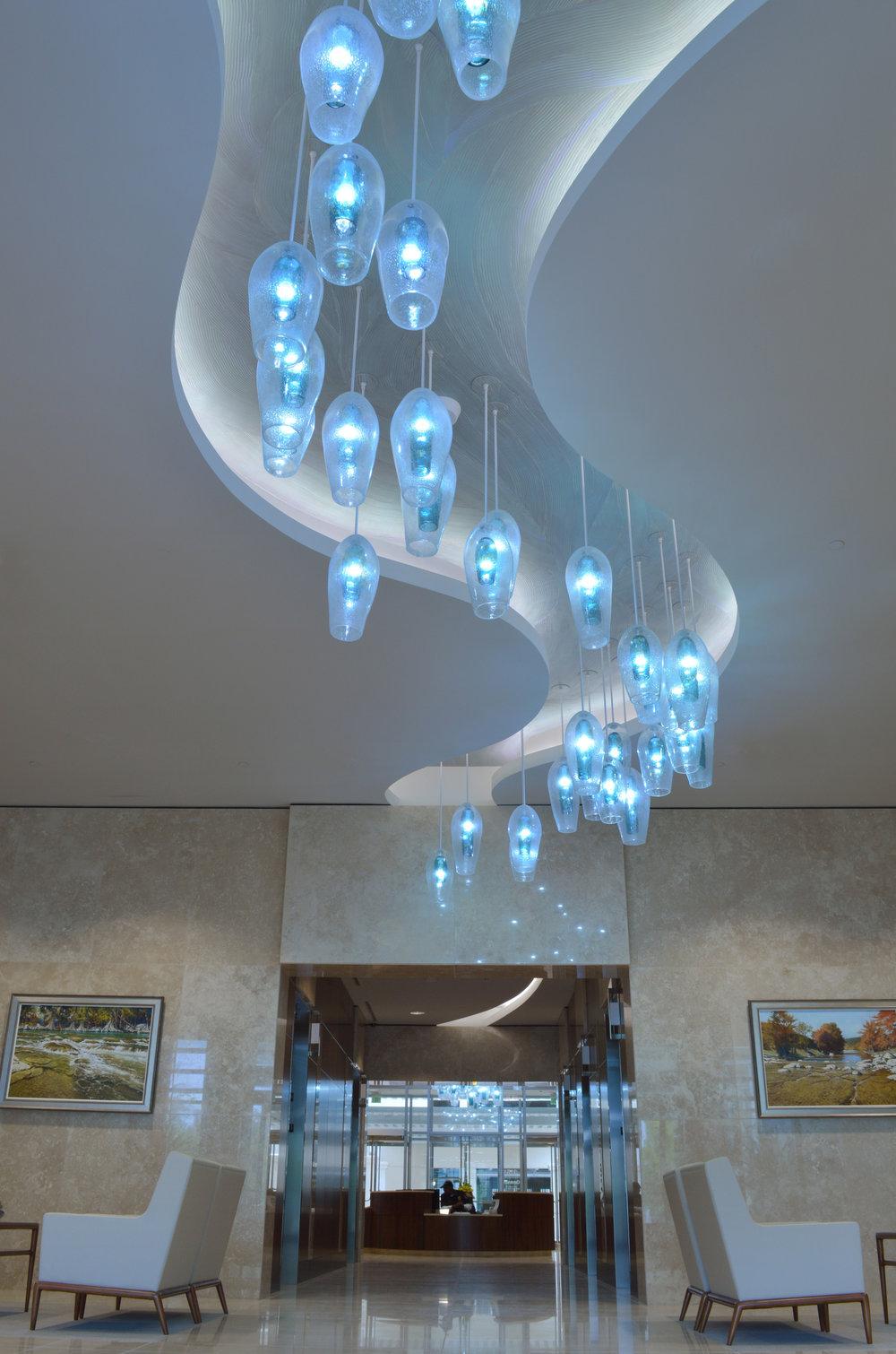 Wimberley Glassworks Briarpark Houston Blown Glass Lighting Installation through lobby shot for web (2).jpg