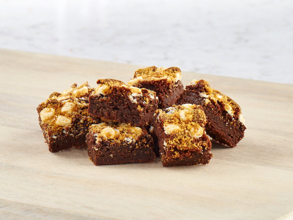 S'MORES BROWNIES   Move over campfires. This little brownie gets loaded with chocolate chips, topped with graham cracker crumbs, and we couldn't forget the toasted mini-marshmallows!  View Ingredients
