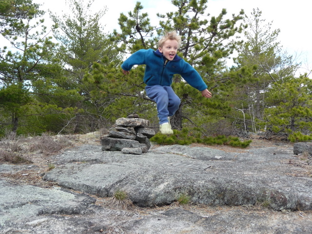 Leaping just a bit higher than the highest point of Higgins Mountain.