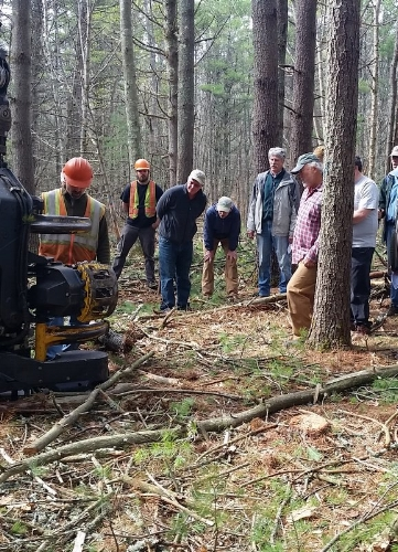 Folks joined KELT staff to learn about the cut-to-length harvester used during the sustainable timber harvest.