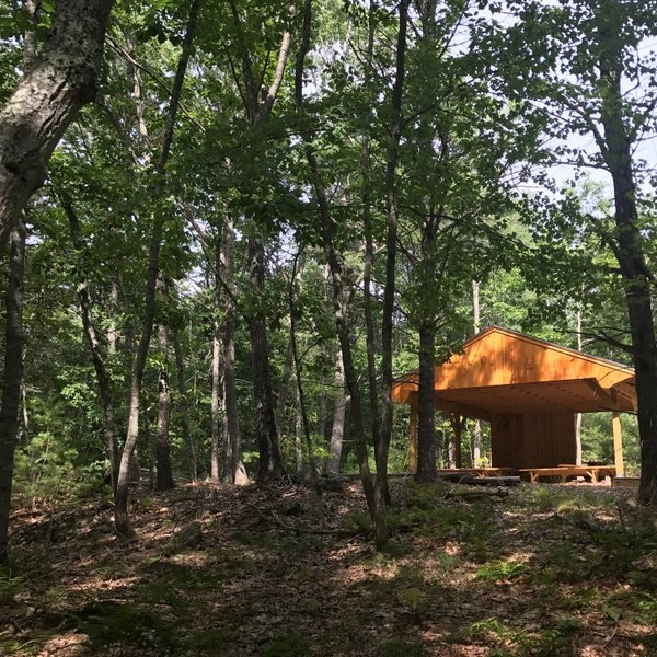 The outdoor classroom pavilion and base camp.