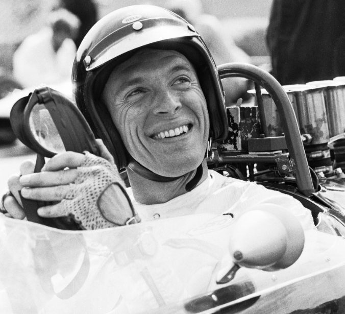 - Dan Gurney aboard his own All American Racers Formula One car before the 1966 British Grand Prix at Brands Hatch.  The photo is from David Bull Publishing's 2013 book McLaren From the Inside: Photographs by Tyler Alexander.