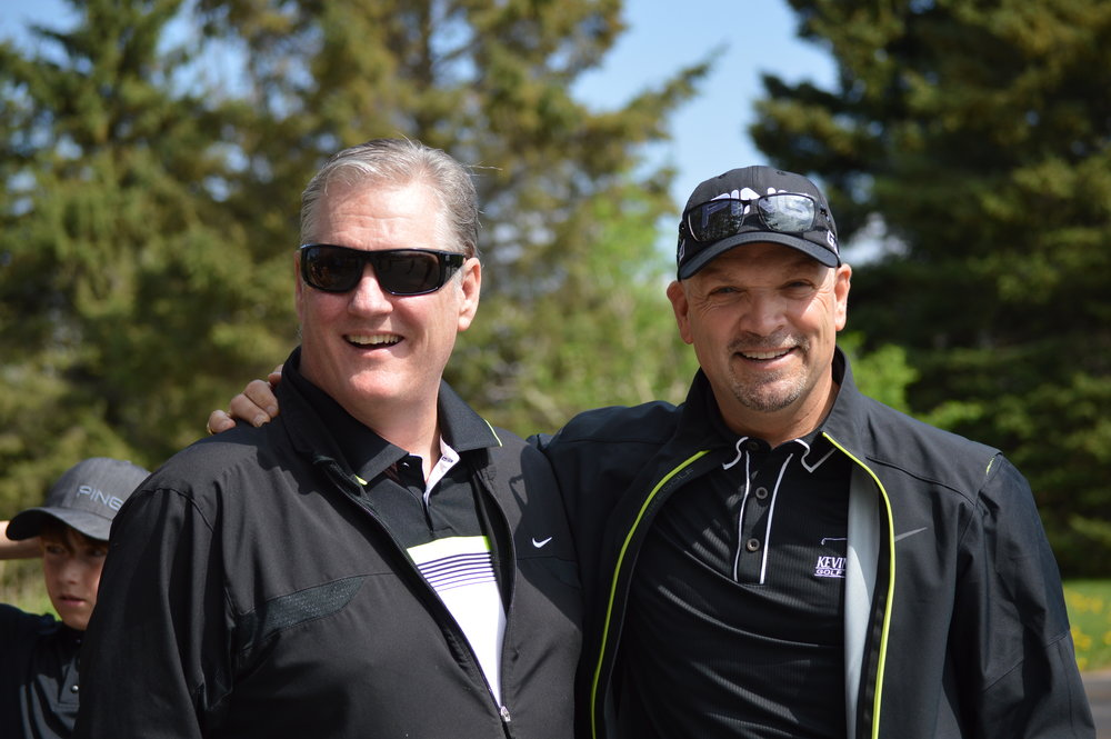 Dean Brown and Kevin Haime  - Dean Brown and Host Kevin Haime smile for the camera after sending the players out onto the course for the morning.