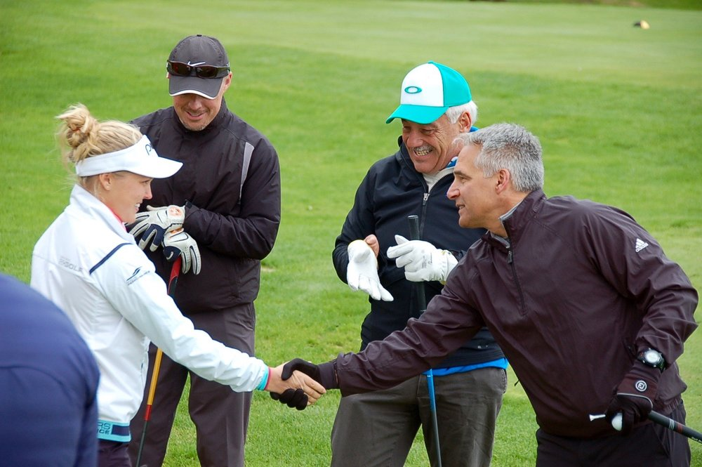 Brooke Henderson - Our group from Cityscape shakes hands with Brooke Henderson.