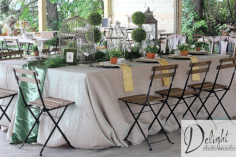Farm decorations include bird cages, clover table runners, crush linens, chargers and gold napkins.