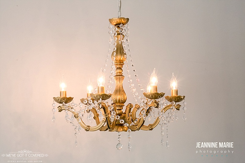 Gold chandelier that can be hung at many outdoor or indoor weddings