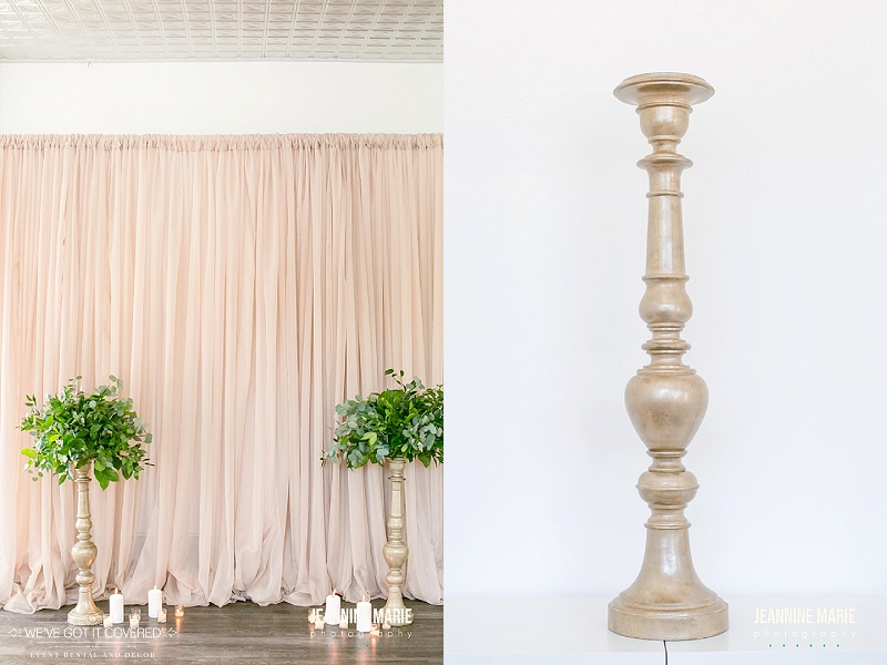 Taupe curtains used for a backdrop or draping at a wedding along with candlesticks used for added decoration