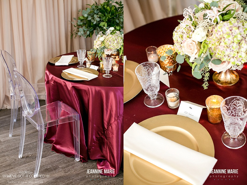 Burgundy table linen that makes gold accents pop along with greenery or crystal decorations