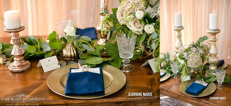 Farm table with gold chargers and navy napkins, garland and candlesticks for centerpiece ideas