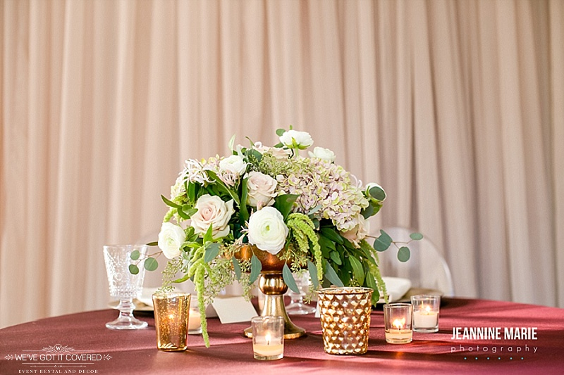 Elegant gold, red, green, white and taupe colors mixed for a wedding reception table