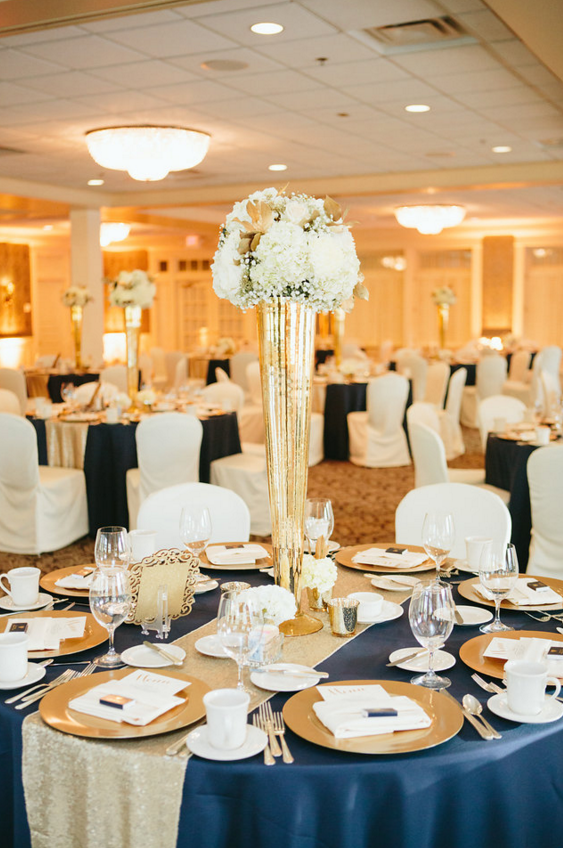 upclose navy table cloths with a gold runner and gold plates