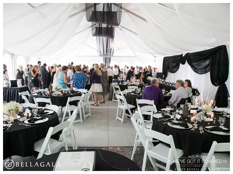 black and white classic style tent wedding with black and white draping and crystal chandeliers