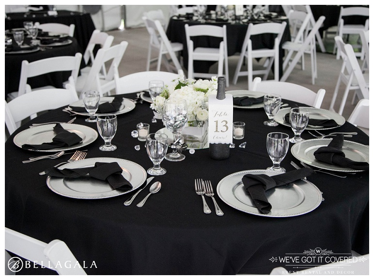 black table cloth inside a tent for a wedding reception
