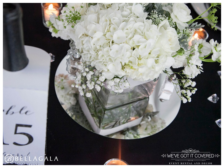 Hydrangea flowers with mirrors and wine bottles used for table decoration