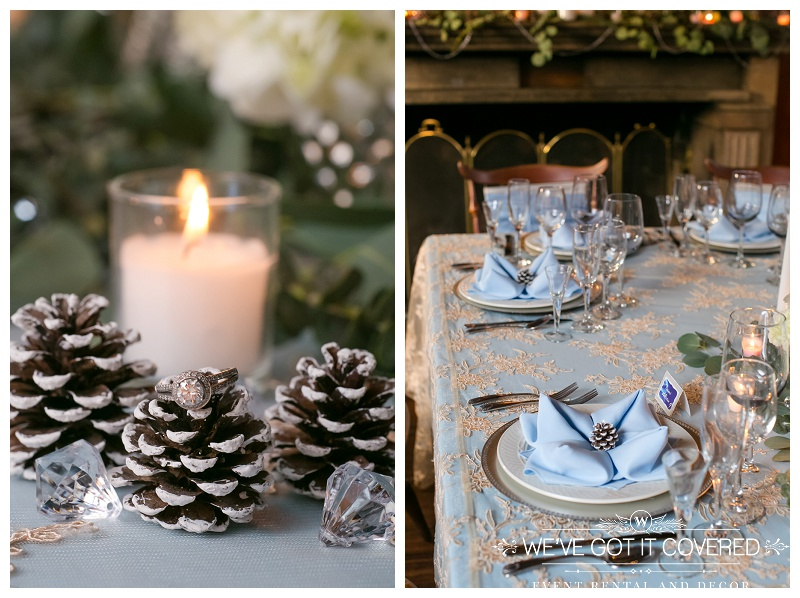 Engagement ring on an acorn with jewels and candlelight next to a winter styled table