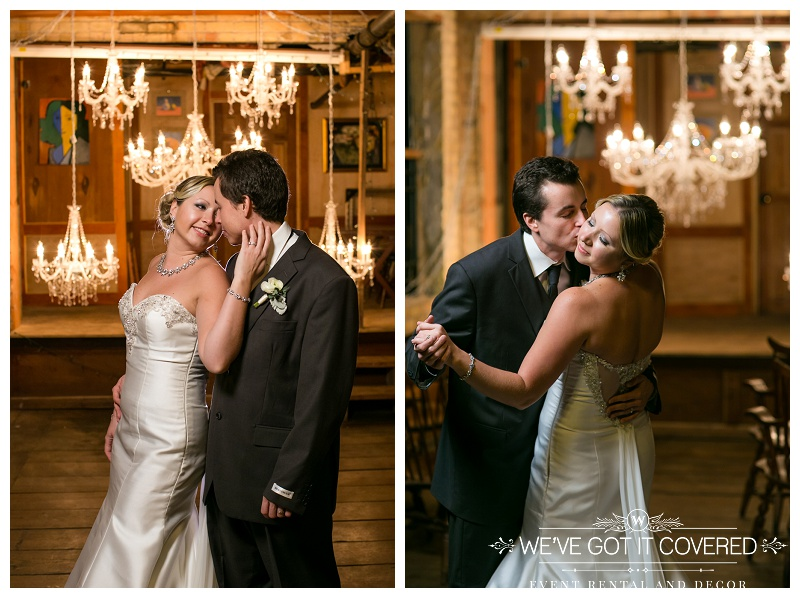 Kisses under a wall of chandeliers hung for extra romance