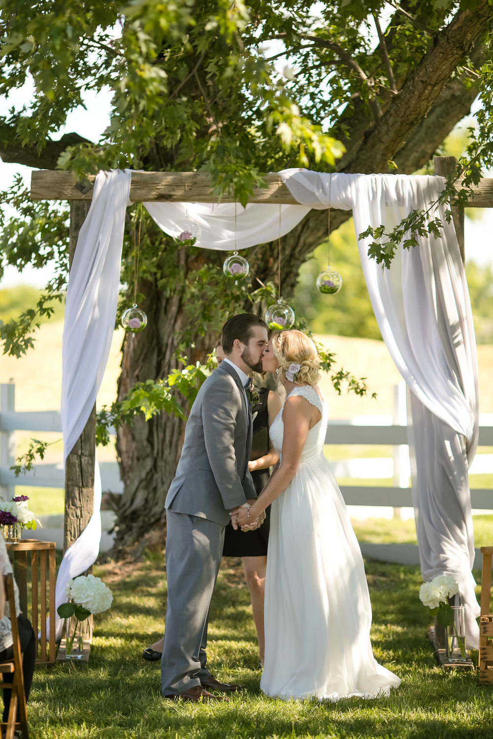 Wedding ceremony arch draping decoration with hanging floral ball vases / arch drapery