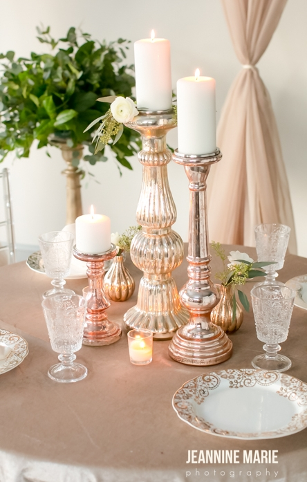 Mercury glass candlestick centerpieces on a champagne linen