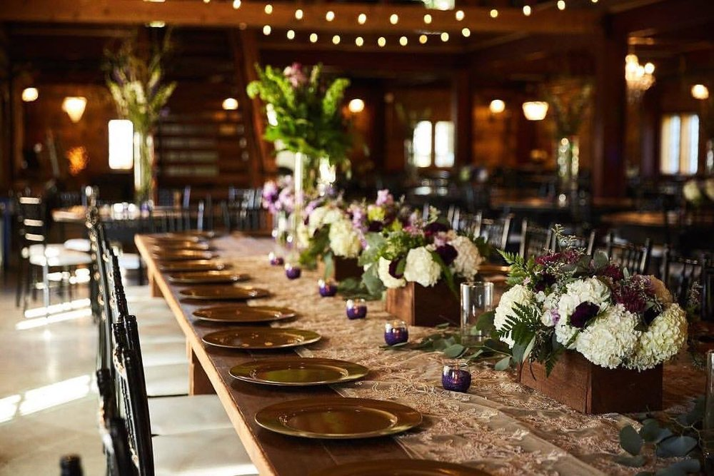 Minnesota farm venue with lace table runners and gold chargers