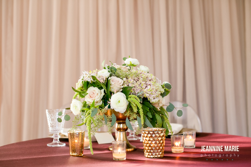 centerpieces displayed on a burgundy table linen