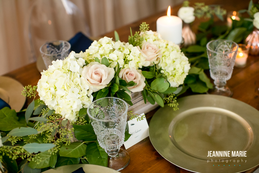 Wedding reception centerpiece ideas including greenery, champagne chargers, and crystal glasses