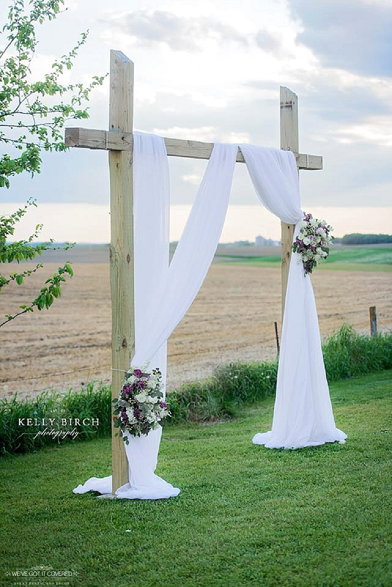 Creative arch draping for a Minnesota outdoor wedding ceremony
