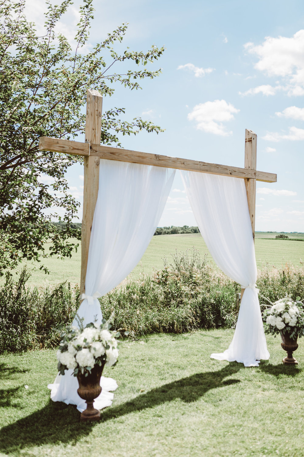 Wedding ceremony arch curtain draping outdoors