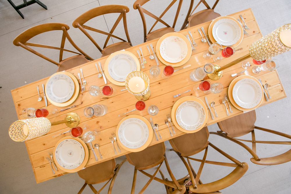 Farmstyle reception decor with gold chargers and candles