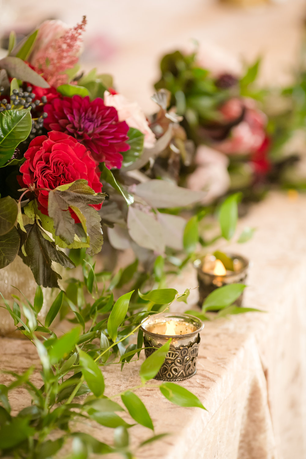 candle accents with garland and flowers