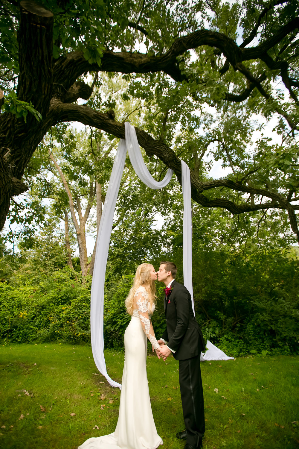 couple kissing under dreamy draping