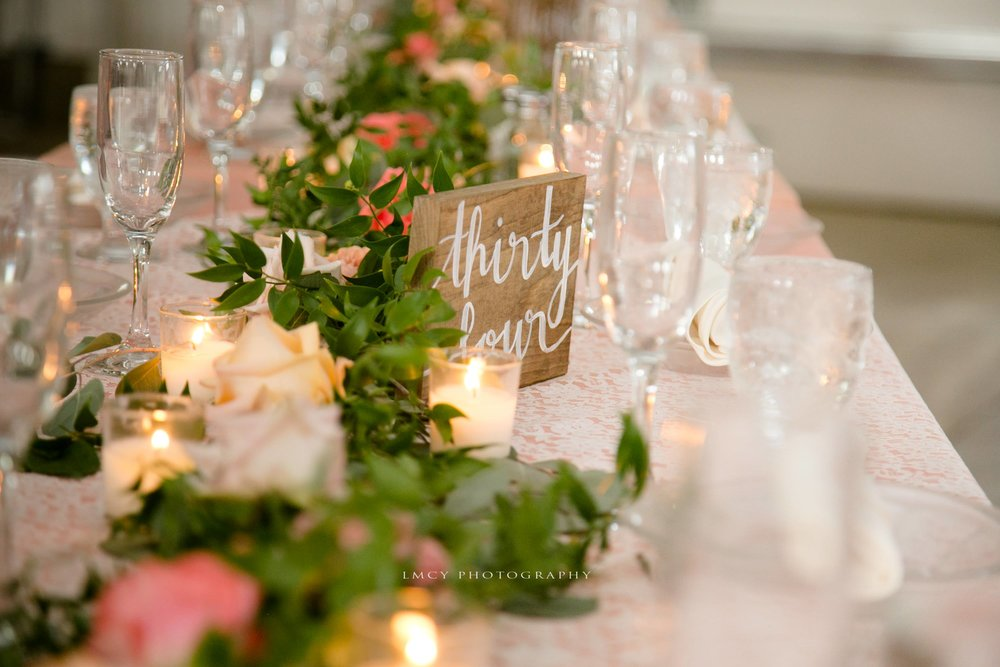 table decor including garland and lace overlays