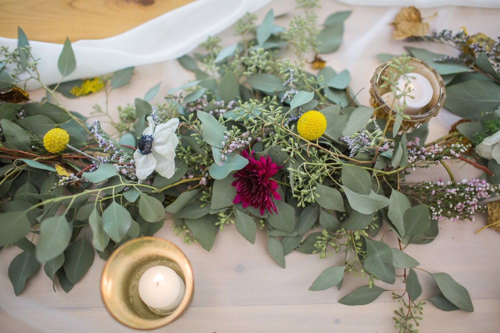 chiffon runner on wood table with green garland
