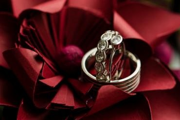 Wedding bands on red ribbon