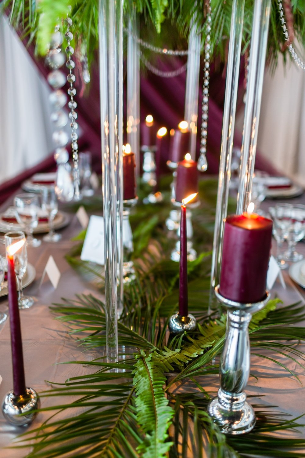 burgundy candles on silver candlesticks