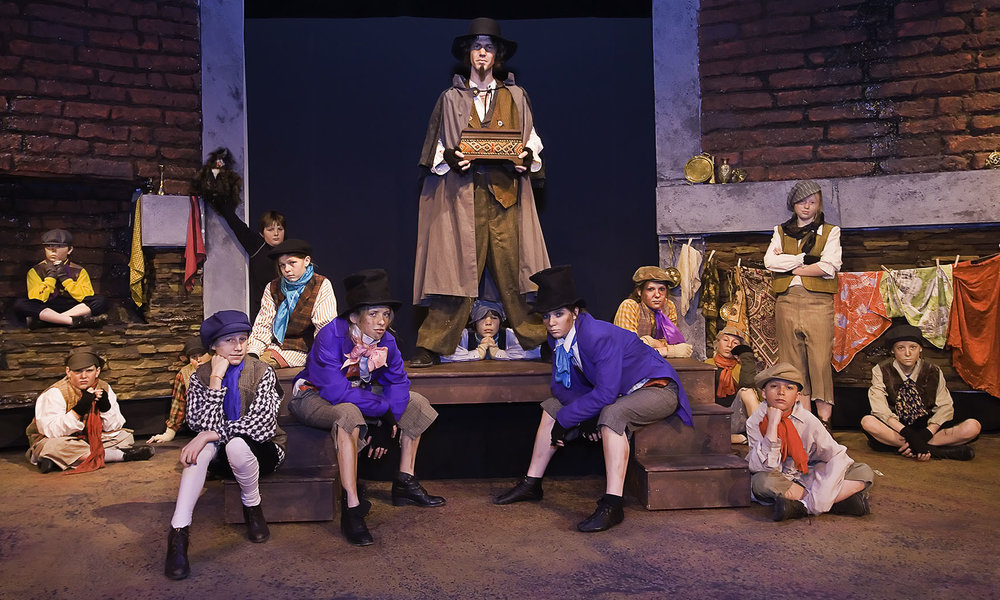 Fagin and his boys in Oliver
