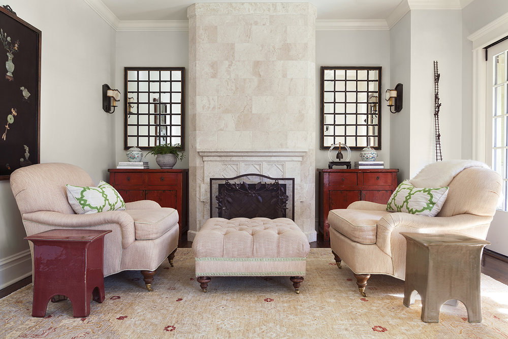 traditional interior design family room with fireplace and pair of iron framed mirrors