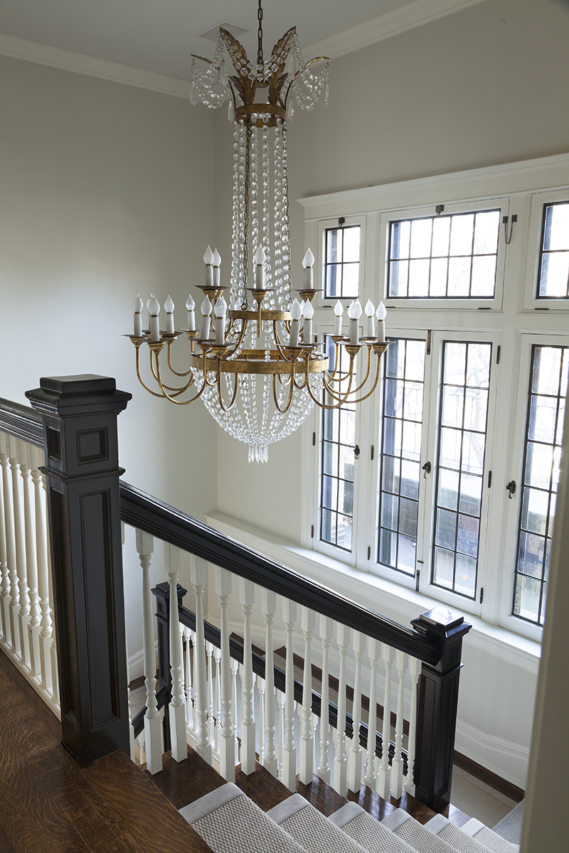 traditional interior design staircase with chandelier