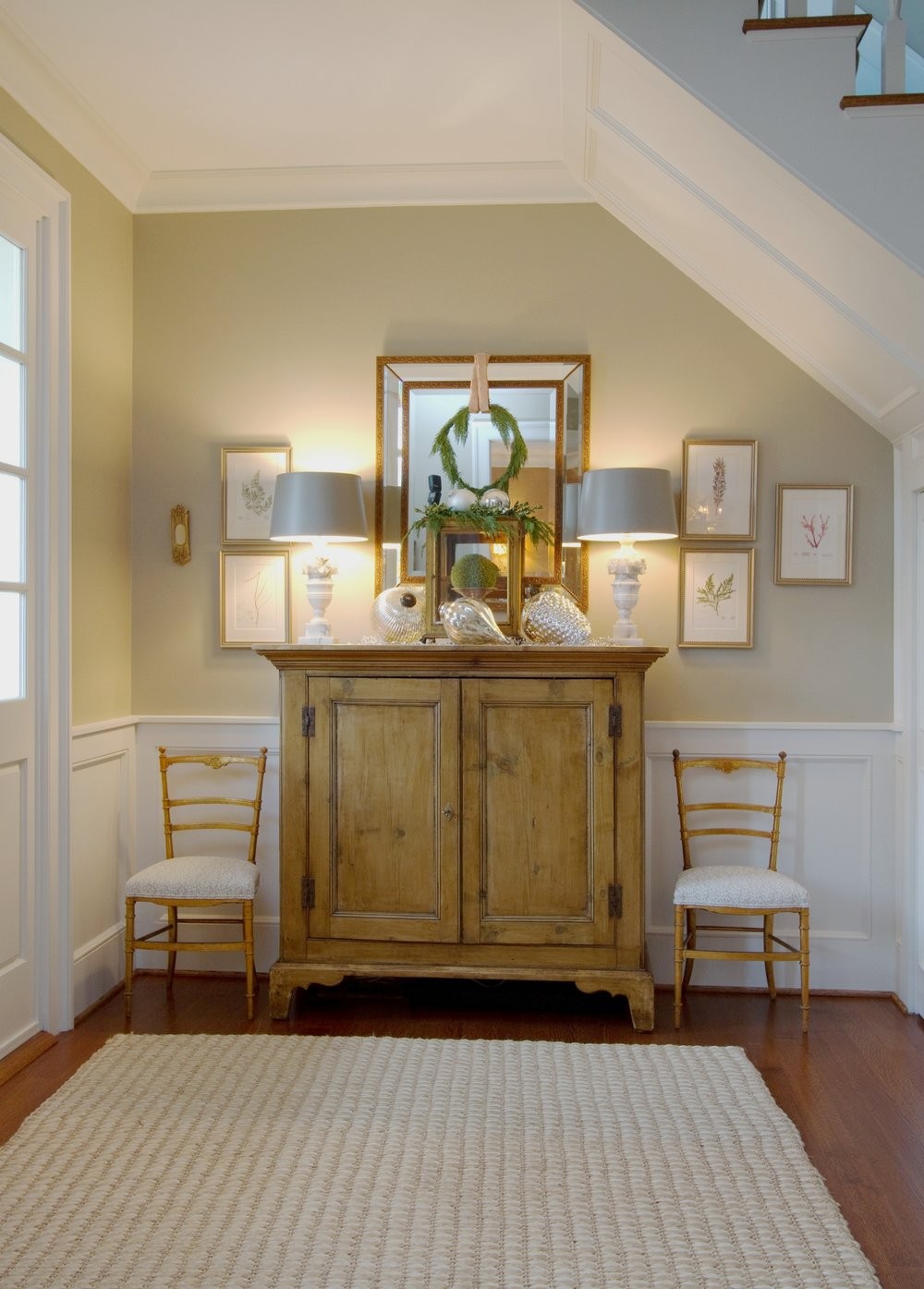 traditional interior design entryway antique pine chest, gold and white chairs