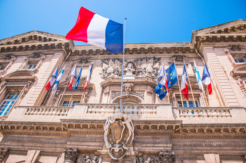 french flag and City streets in Marseille France